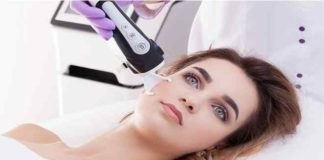 Doctor Woman making to a patient laser skin resurfacing in aesthetic medicine